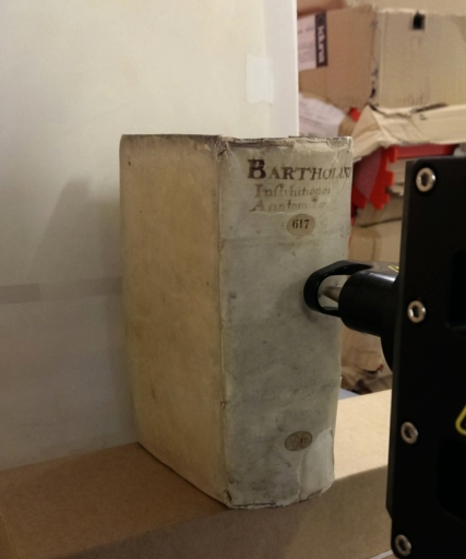 The head of the MA-XRF scanner working at the 16th-century binding of Leiden, University Library, 617 F 19